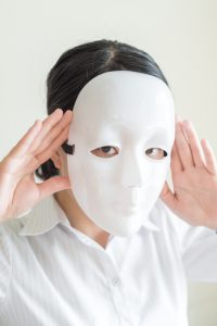 Asian woman wearing white mask