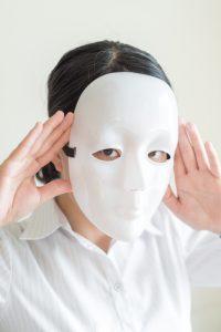 Asian woman wearing white mask