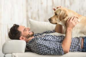 man resting with his dog at home-img-blog