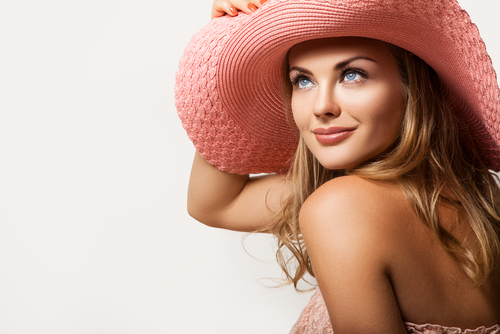 woman in a peach hat on her head, beautiful model face and soft skin-img-blog